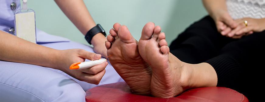 examine nerve on a woman's feet for CIDP